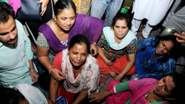 Relatives of train accident victims break down near the railway tracks in Amritsar where the accident took place.