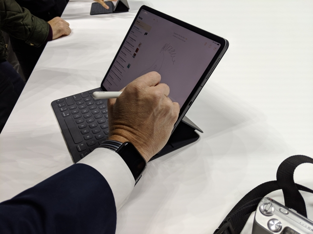 The second generation Apple Pencil attached magnetically to the iPad Pro.