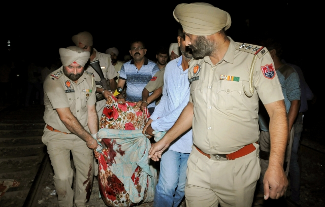 Police carry casualties of the Amritsar train accident, even as rescue operations continue in earnest.