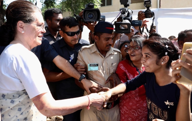 UPA chairperson Sonia Gandhi is greeted by elated supporters.