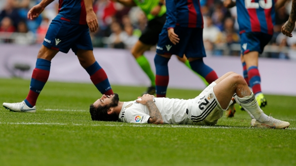 Real Madrid's Isco lies on the ground during a Spanish La Liga soccer match between Real Madrid and Levante at the Santiago Bernabeu stadium in Madrid, Spain.
