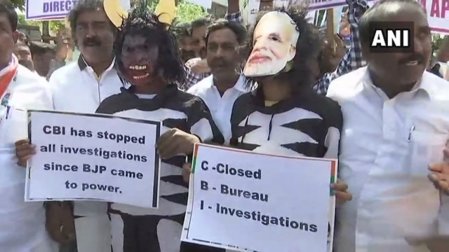 Congress workers hold a protest outside the CBI office in Bengaluru against the removal of CBI director Alok Verma.