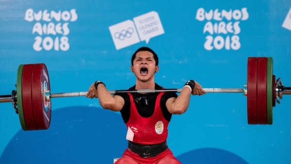 The 15-year-old lifted a personal best total of 274kg (124kg +150kg) in the men's 62kg weight category in Buenos Aires.