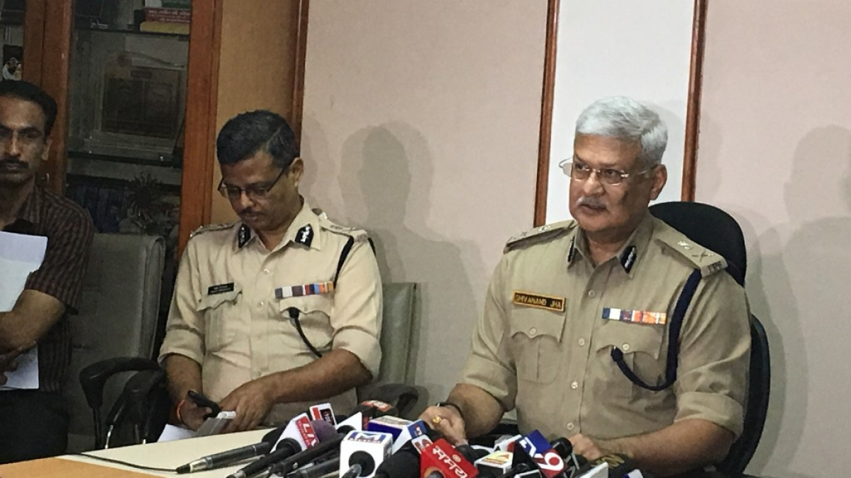 DGP of Gujarat Shivanand Jha holds a press conference in Gandhinagar on Sunday.