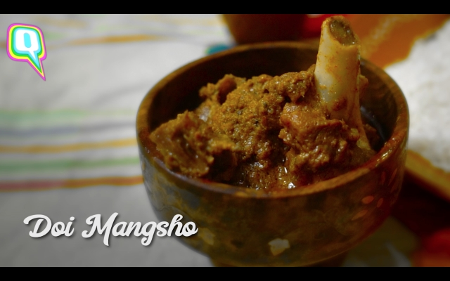 Doi Mangsho or mutton cooked in curd.