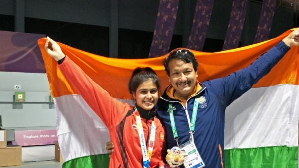 Manu Bhaker (left) with her coach Jaspal Rana.