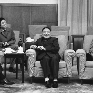 File image of President Gerald R Ford, First Lady Betty Ford, Vice Premier Deng Xiao Ping, and Deng's interpreter having a conversation during an Informal meeting.