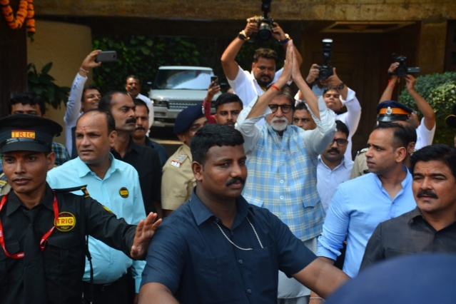 Bachchan greets fans.