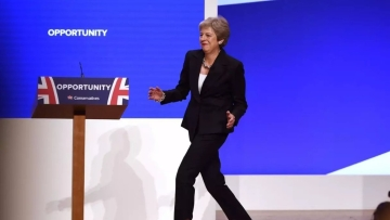 Entering with her famous 'Maybot' dance. Cringeworthy or entertaining?