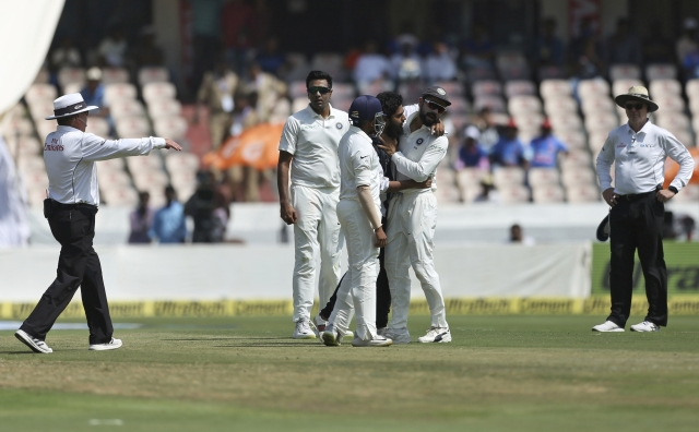 India captain Virat Kohli was seen trying to avoid the man's hug as the security personnel came and whisked him away.