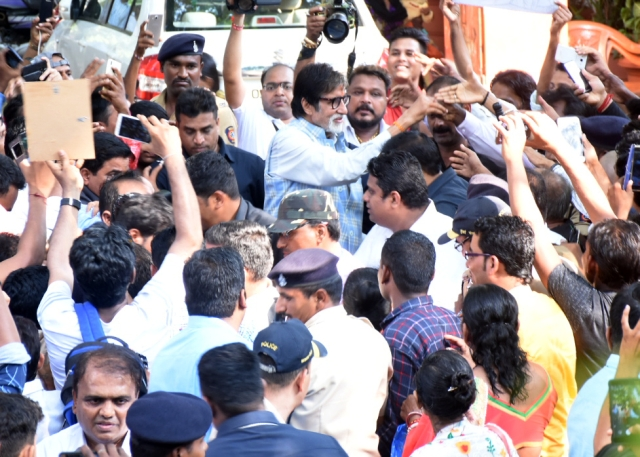 Bachchan waves at the fans.