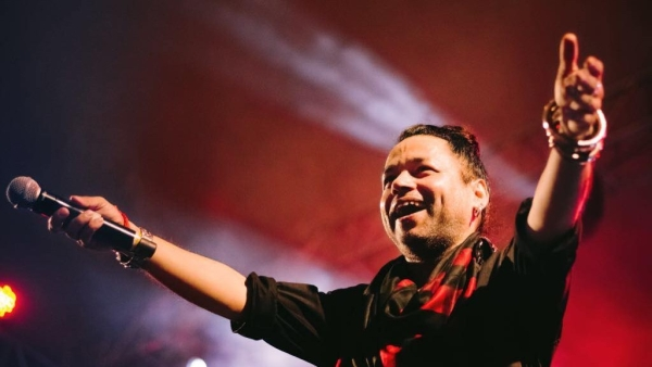 Kailash Kher performing at a concert.