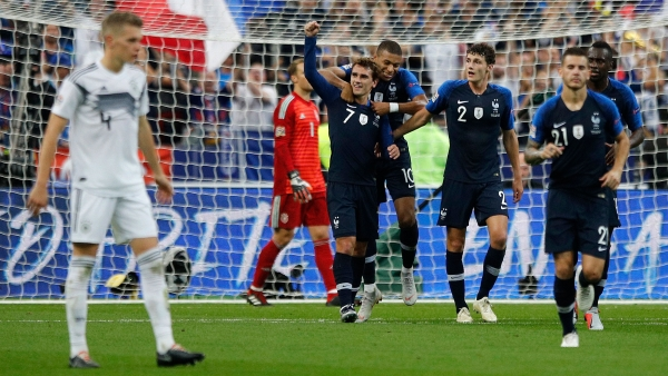 France's Antoine Griezmann, center, clenches his fist after scoring his second goal during their UEFA Nations League soccer match between France and Germany.