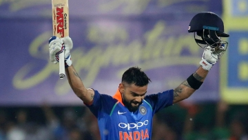 Virat Kohli after reaching his century against West Indies in the first ODI at Guwahati on Sunday.