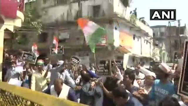Congress workers hold a protest outside the CBI office in Lucknow against the removal of CBI Director Alok Verma.