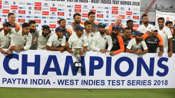 The Indian team celebrate after winning the Test series against West Indies.