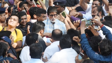 Amitabh Bachchan greets fans on his birthday.