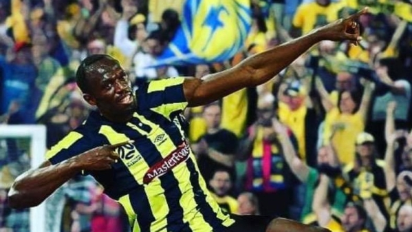 Usain Bolt celebrates after scoring a goal for the Central Coast Mariners.