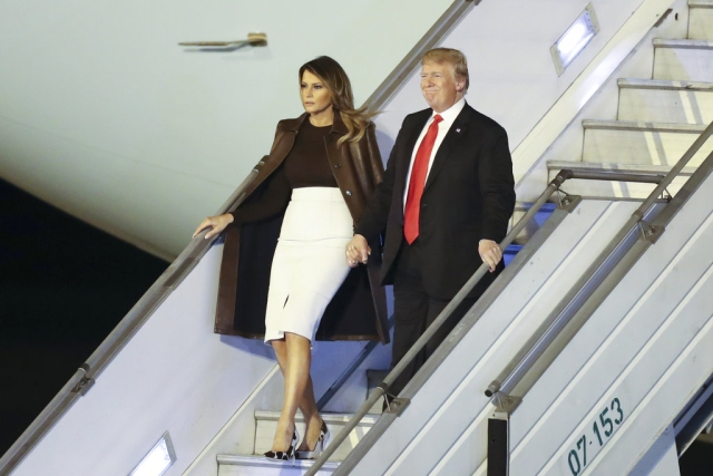 President Donald Trump and first lady Melania Trump walk from Air Force One as they arrive at the Ministro Pistarini international airport in Buenos Aires, Argentina,to attend the G20 summit.