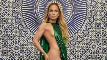 Jennifer Lopez flaunts a sequin Valentino Haute Couture cape.