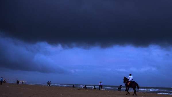 Dark clouds hover over Marina beach in Chennai on Thursday, 15 November, before the arrival of Cyclone 'Gaja'.