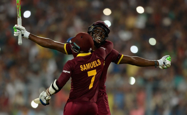 Carlos Brathwaite and Marlon Samuels celebrate after winning the 2016 ICC World T20.