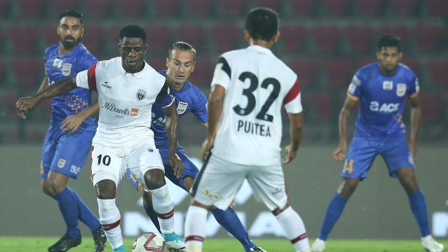 Bartholomew Ogbeche of Northeast United FC trying to score during match against Mumbai City FC in Guwahati.