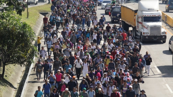 Migrants from El Salvador start on their way to the United States border (1,500 miles away), in San Salvador, on Wednesday, 31 October 2018.