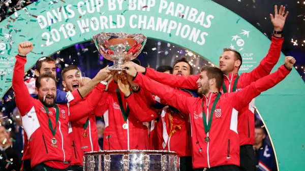 Croatia's team captain Zeljko Krajan (left) and players lift up the cup after the team won the Davis Cup final between France and Croatia on Sunday, November 25, 2018 in Lille in France.