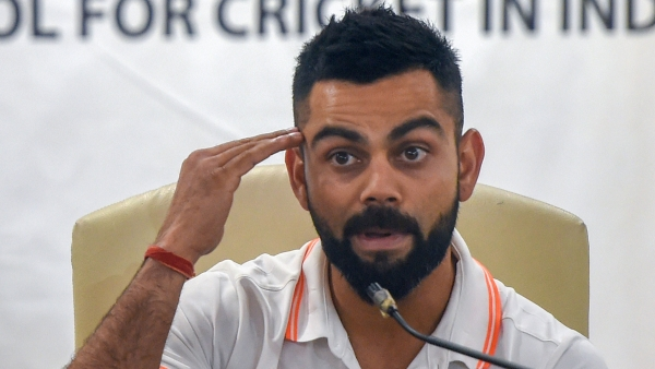 Virat Kohli speaks to the media ahead of India's tour of Australia on Thursday.