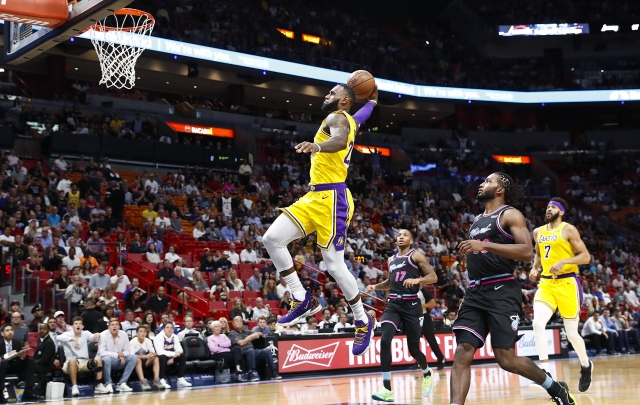 Los Angeles Lakers forward LeBron James scores during the first quarter of an NBA basketball game against the Miami Heat, Sunday, Nov. 18, 2018, in Miami, Fla.