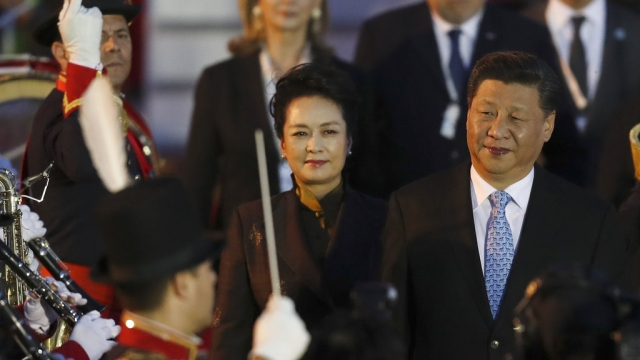 China's President Xi Jinping and first lady Peng Liyuan arrive at the Ministro Pistarini international airport in Buenos Aires, Argentina.