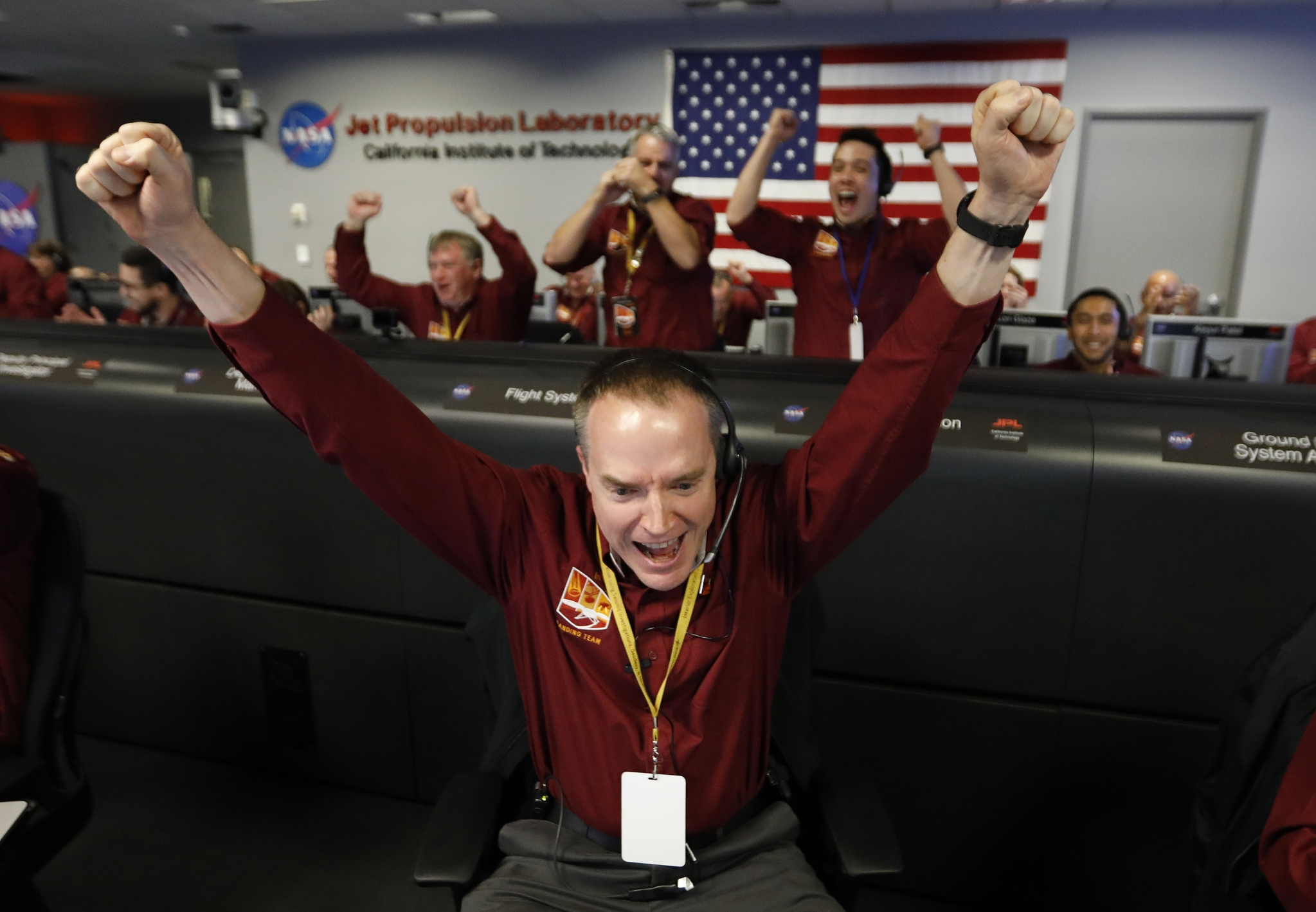 Scientists celebrate the landing of InSight.&nbsp