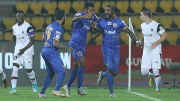 Mumbai City FC players celebrate their winning goal against NorthEast United FC in Guwahati on Friday.
