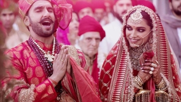 Ranveer and Deepika in a candid moment during the ceremony.