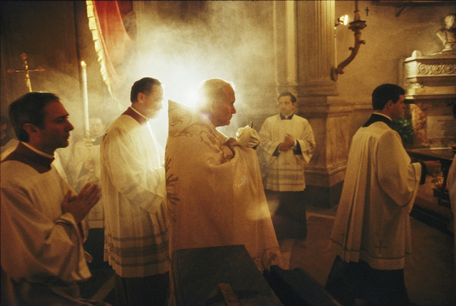 Pope John Paul II carries Holy Communion before Mass on Holy Thursday in Rome, 1985.