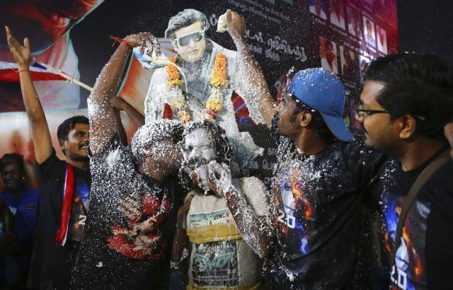 Fans of Tamil superstar Rajinikanth celebrate before the screening of '2.0' on Thursday 29 November, outside a cinema hall in Mumbai.
