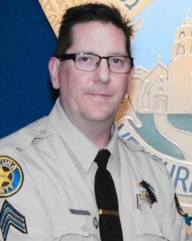 Sergeant Ron Helu was killed in the shooting.