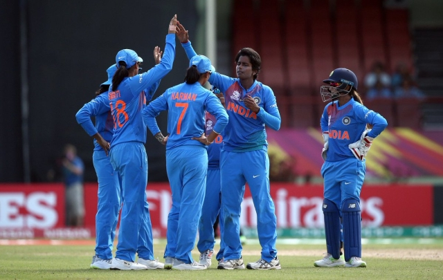 India rejoice at the fall of a New Zealand wicket during their WT20 opener in Guyana