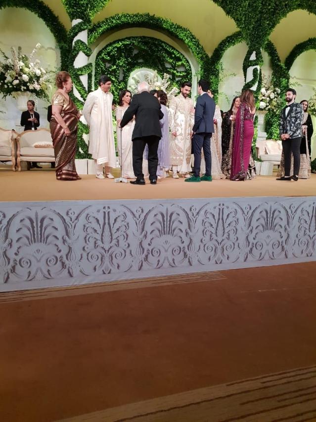 Prakash Padukone and Ujjala Padukone greet the guests with the couple.