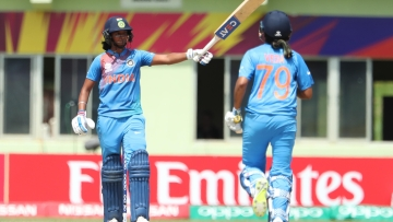 Harmanpreet Kaur celebrates after reaching a 100 in India's WT20 opener vs NZ