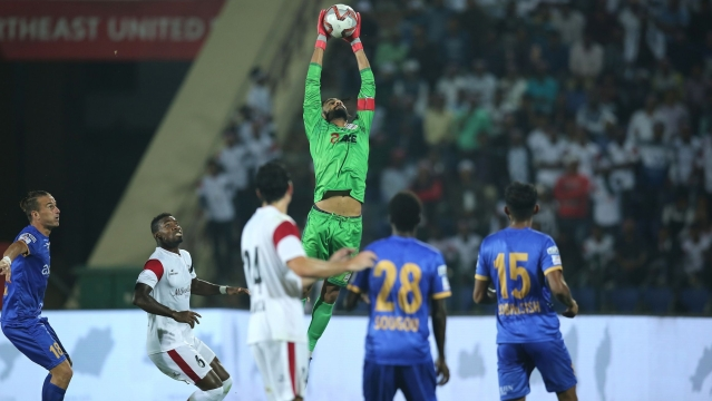 Mumbai's goalkeeper Amrinder Singh in action against Northeast United in Guwahati on Friday.
