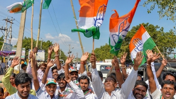 Congress supporters celebrate party candidate VS Ugrappa's win.