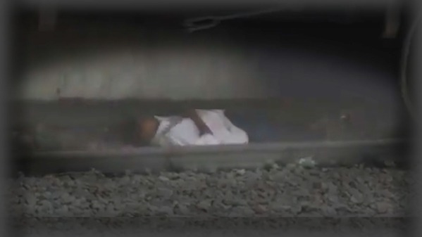 Man lies on track as train passes over him in Andhra Pradesh.