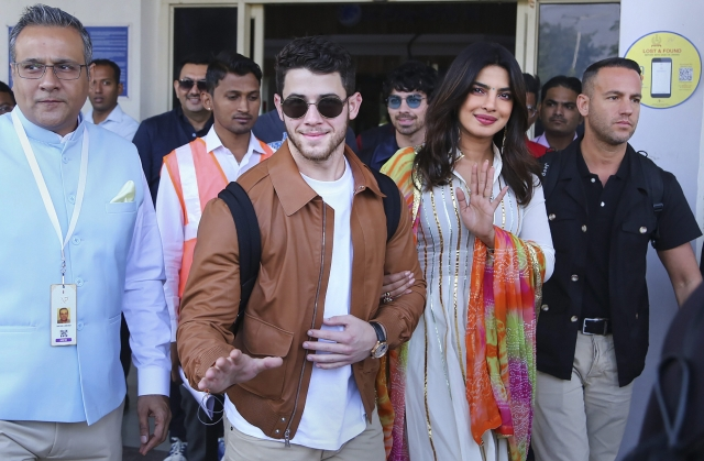 Bollywood actor Priyanka Chopra and fiance Nick Jonas arrive at Jodhpur airport, Thursday, Nov. 29, 2018.