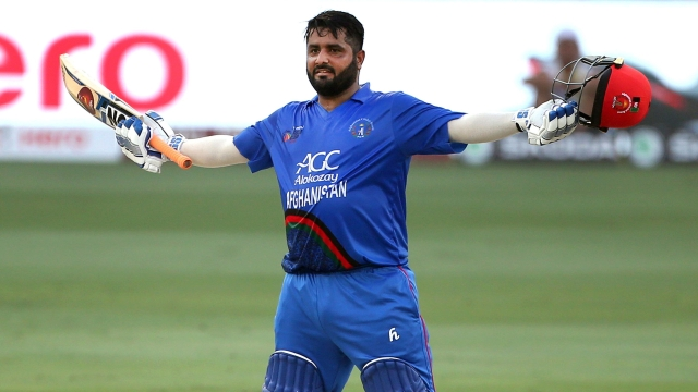 File photo: Mohammad Shahzad celebrates after reaching a hundred during Afghanistan's Asia Cup 2018 Super Four tie against India