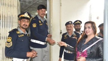 Laila Ali receives her license from the Islamabad Traffic Police.