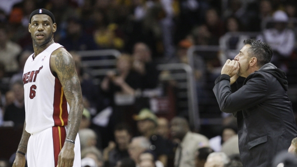 In this Thursday, Dec. 2, 2010, file photo, a Cleveland Cavaliers fan yells at Miami Heat forward LeBron James (6) during the first quarter of an NBA basketball game in Cleveland.