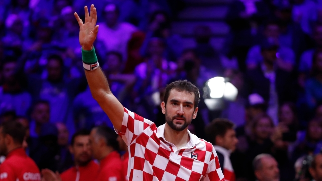 Croatia's Marin Cilic waves after defeating France's Lucas Pouille during the Davis Cup final between France and Croatia on Sunday, Novemeber 25 in Lille.