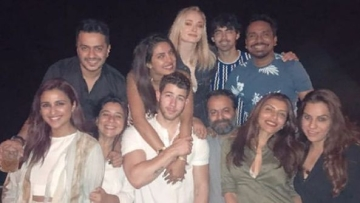 Priyanka Chopra and Nick Jonas with friends and family.